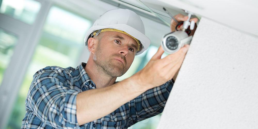 Engineer fitting a CCTV Camera